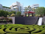 Getty Central Garden Hedge with stone fountain and building background