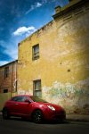 Leichhardt Building with Red Alfa Romeo. N. Hayter. 2010.