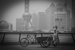 Shanghai Man with Tricycle. The Bund. Pudong background. N.Hayter 2010.
