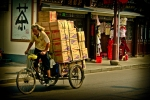Delivery man on bike, Shanghai China. N.Hayter 2010.